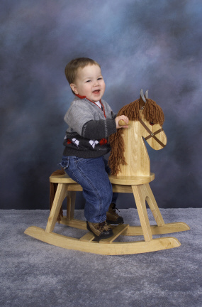 Zachary on a Wooden Horse